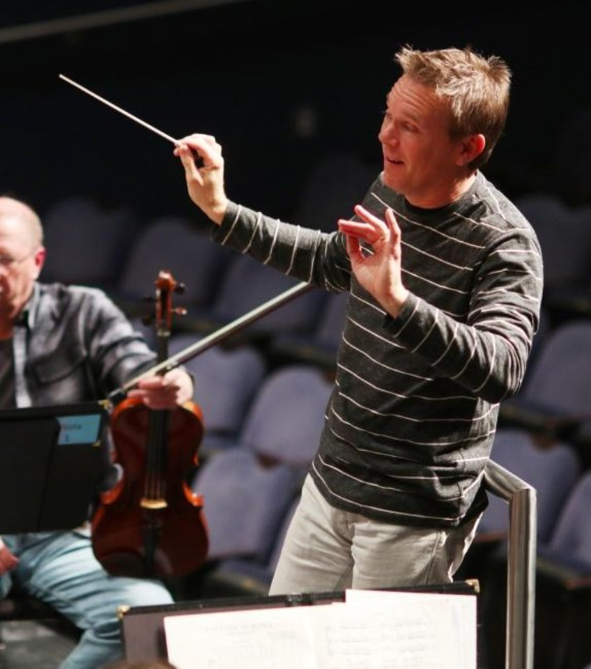 Photo -  Music Director Alexander Mickelthwate leads the Oklahoma City Philharmonic rehearsals Tuesday, October 29, 2019. [Doug Hoke/The Oklahoman]