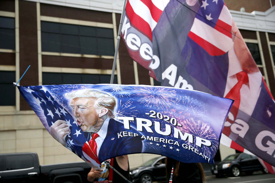 Photo - Trump supporters wave flags in downtown Tulsa, Okla., ahead of President Donald Trump's Saturday campaign rally, Friday, June 19, 2020. [Sarah Phipps/The Oklahoman]