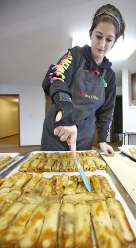 Photo -  In this 2016 photo, a Corn Bible Academy student makes a pastry called schnetka for the school's annual German Feast and Auction in Corn. [The Oklahoman Archives]