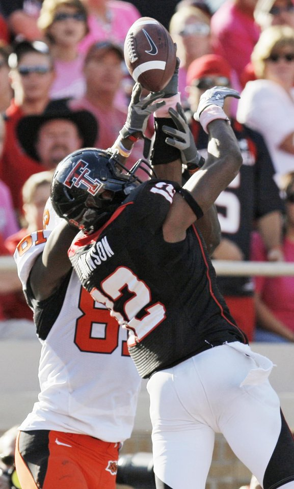 Photo - Texas Tech's D.J. Johnson (12) intercepts a pass intended for OSU's Justin Blackmon (81) in the third quarter during the college football game between the Oklahoma State University Cowboys and Texas Tech University Red Raiders at Jones AT&T Stadium in Lubbock, Texas, Saturday, October 16, 2010. OSU won, 34-17. Photo by Nate Billings, The Oklahoman