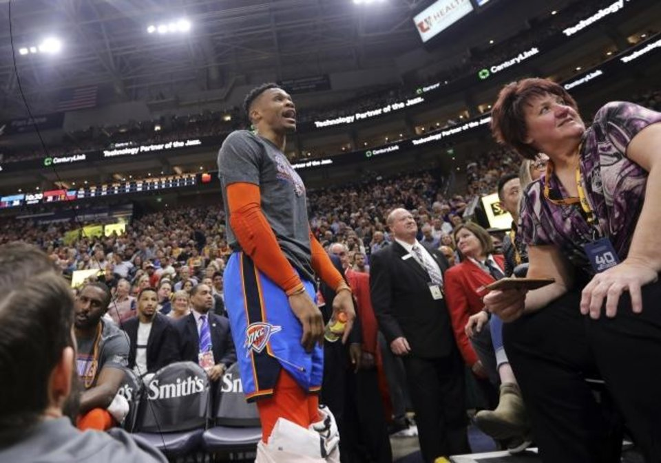 Photo -  Thunder superstar Russell Westbrook got into a heated verbal altercation with a Utah Jazz fan on Tuesday night. Wednesday afternoon, the Jazz banned the fan from future games and the NBA fined Westbrook $25,000. [AP PHOTO]