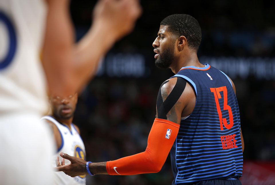 Photo - Oklahoma City's Paul George (13) reacts to a play during the NBA basketball game between the Oklahoma City Thunder and the Golden State Warriors at Chesapeake Energy Arena,  Saturday, March 16, 2019. Photo by Sarah Phipps, The Oklahoman