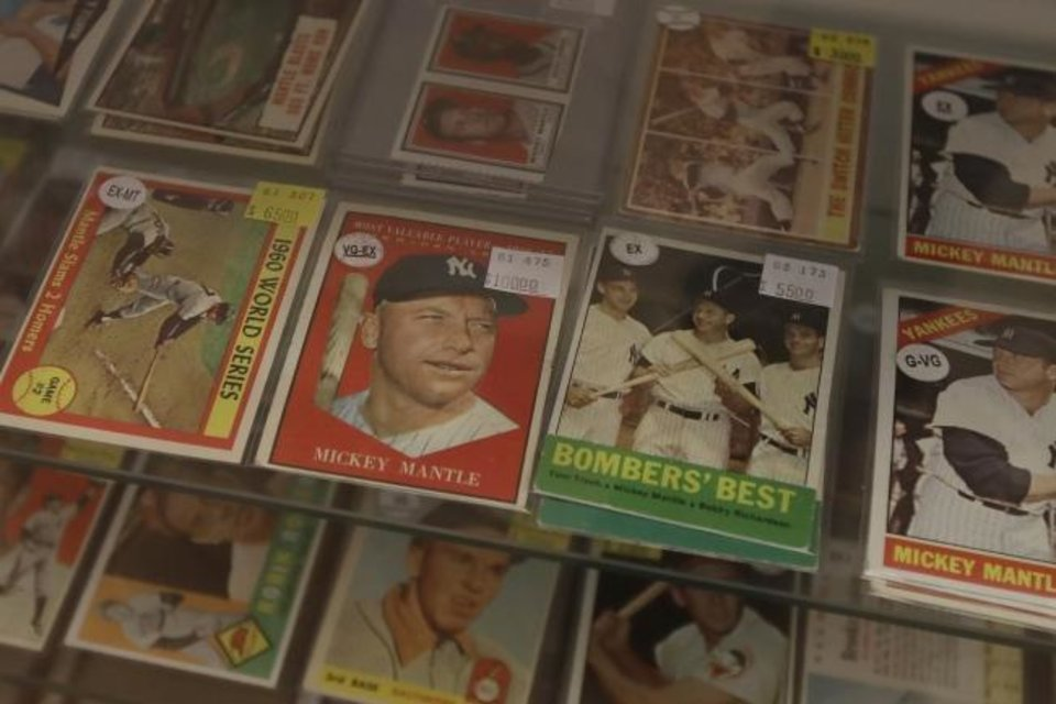 Photo -  Baseball cards of former New York Yankees player Mickey Mantle are displayed with other players at Lefty's Sports Cards in Burlingame, Calif., on April 25. [AP Photo/Jeff Chiu]