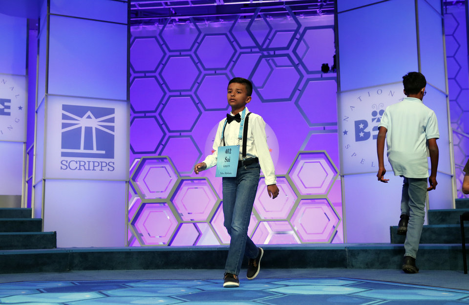 Photo - Saisurya Lakkimsetti, 9, from Tulsa, Okla., walks to the microphone during the 2nd Round of the Scripps National Spelling Bee, Tuesday, May 29, 2018, in Oxon Hill, Md. (AP Photo/Alex Brandon)