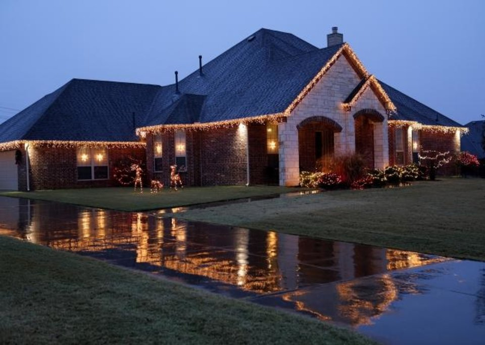 Photo -  Christmas decorations at 16157 Silver Run Drive in Choctaw. [DOUG HOKE/THE OKLAHOMAN]