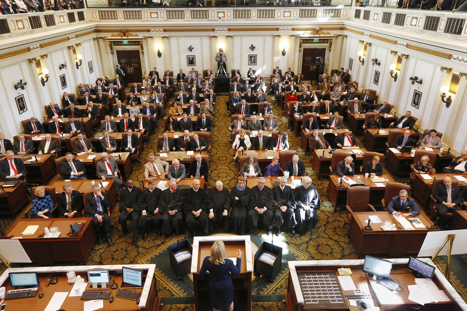 Photo - Gov. Mary Fallin addresses a joint session of the Oklahoma Legislature in the House Chamber Monday afternoon, Feb. 2, 2015. Representatives and Senators were joined by the governor's cabinet and staff, as well as Supreme Court Justices and other members of the judiciary, to hear Fallin's 34-minute talk to the lawmakers on the first day of the 55th Legislature, first session. The governor outlined her goals and priorities for the current session.  Photo by Jim Beckel, The Oklahoman