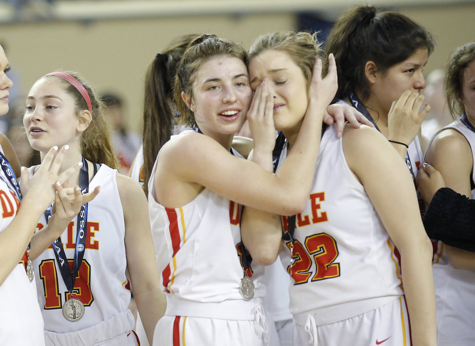 Photo - Dale's Lindy Nowakowski, left, and Lacey Savage react following losing the 2A girls state high school basketball championship to Howe at Jim Norick State Fair Arena, the Big House, at State Fair Park in Oklahoma City,  Saturday, March 9, 2019. Photo by Sarah Phipps, The Oklahoman