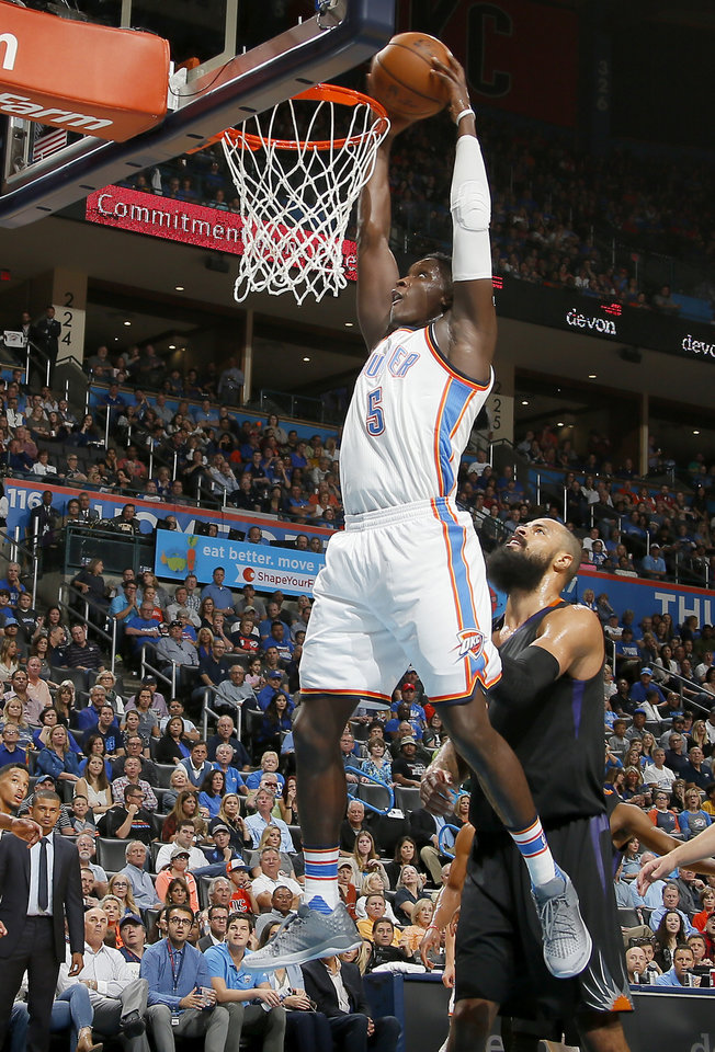 Photo - Oklahoma City's Victor Oladipo (5) goes to the basket in front of Phoenix's Tyson Chandler (4) during an NBA basketball game between the Oklahoma City Thunder and the Phoenix Suns at Chesapeake Energy Arena in Oklahoma City, Friday, Oct. 28, 2016. Photo by Bryan Terry, The Oklahoman