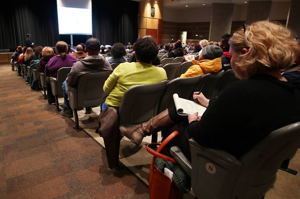 Photo - School Superintendent Sean McDaniel goes over the plans at a community meeting at Frederick A. Douglass High School, hosted by Oklahoma City Public Schools, to get input on the district's plan to consolidate schools, Tuesday, January 29, 2019.  Photo by Doug Hoke, The Oklahoman