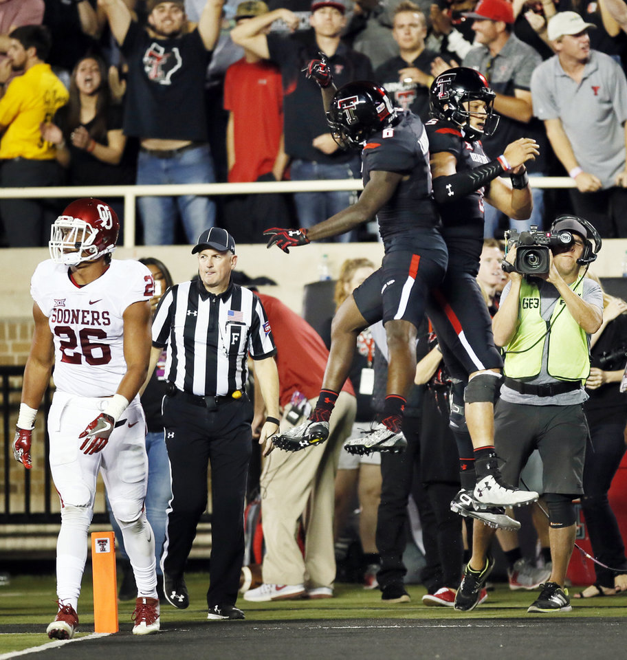 Photo - Texas Tech's Patrick Mahomes II (5), right, and Devin Lauderdale (6) celebrate a touchdown by Mahomes near Oklahoma's Jordan Evans (26) in the second quarter during a college football game between the University of Oklahoma Sooners (OU) and Texas Tech Red Raiders at Jones AT&T Stadium in Lubbock, Texas, Saturday, Oct. 22, 2016. Photo by Nate Billings, The Oklahoman