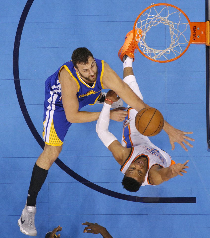 Photo - Oklahoma City's Russell Westbrook (0) goes to the basket past Golden State's Andrew Bogut (12) during Game 3 of the Western Conference finals in the NBA playoffs between the Oklahoma City Thunder and the Golden State Warriors at Chesapeake Energy Arena in Oklahoma City, Sunday, May 22, 2016. Photo by Bryan Terry, The Oklahoman