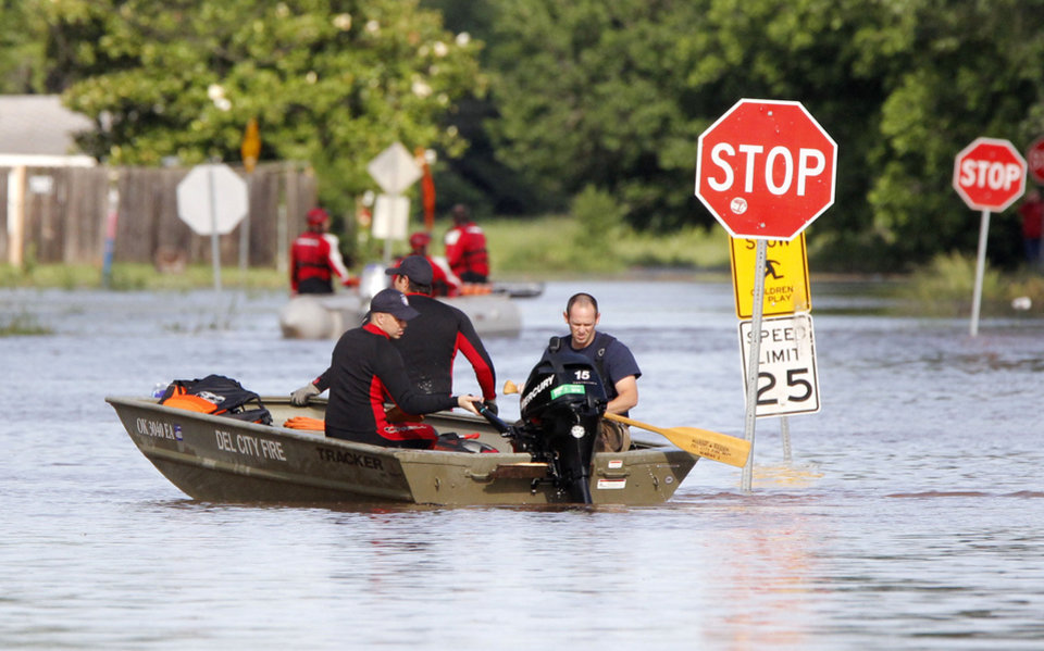 Photo - Del City and Edmond Fire Dept. rescue crews use boats to rescue residents from a flooded mobile home park off of Air Depot Blvd. between NE 10th and NE 23rd St. in Midwest City, OK, Saturday, June 1, 2013, after up to eight inches of rain fell during the previous 24 hours. Photo by Paul Hellstern, The Oklahoman