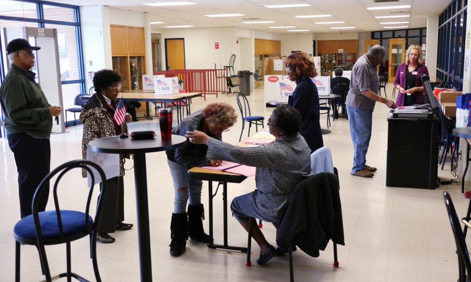 Photo - Voters at Millwood High School Arena, precinct 114, take part in Super Tuesday, March 3, 2020.  [Photo by Doug Hoke/The Oklahoman]