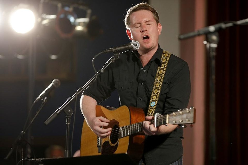 Photo - John Fullbright performs during a Jimmy LaFave tribute inside the Crystal Theatre to start the 20th annual Woody Guthrie Folk Festival in Okemah, Wednesday, July 12, 2017. [Photo by Bryan Terry, The Oklahoman Archives]