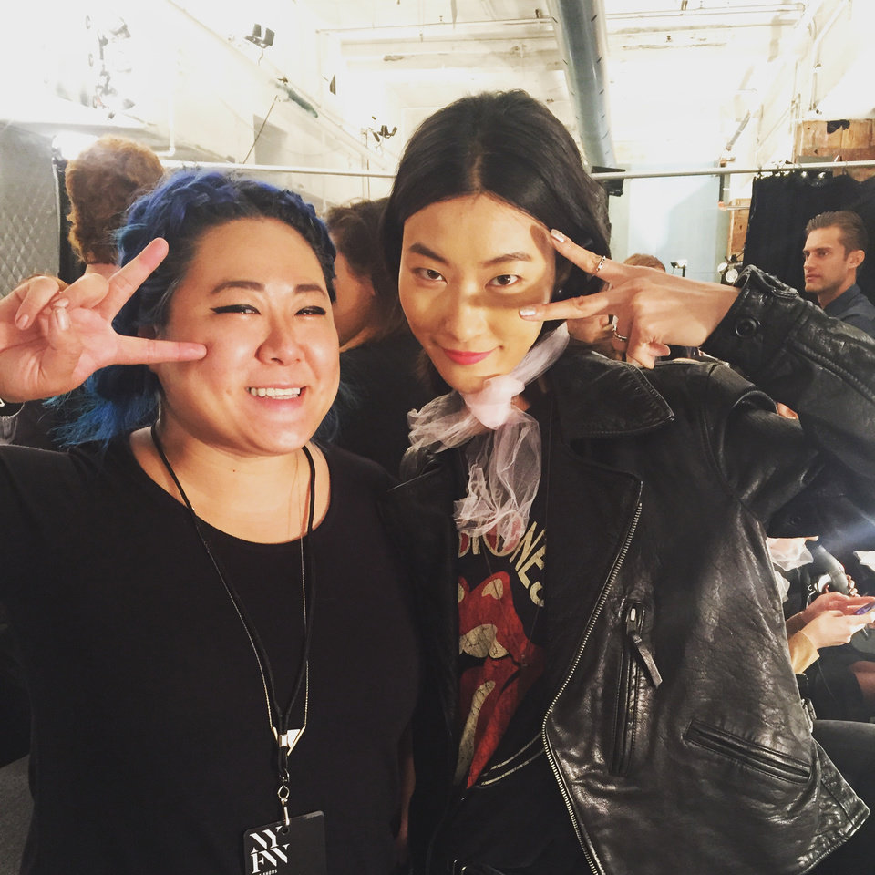 Photo - Trichology Salon stylist Dianna Truong with one of the models at the Badgley Mischka spring 2016 runway show during New York Fashion Week. (Provided Photo)