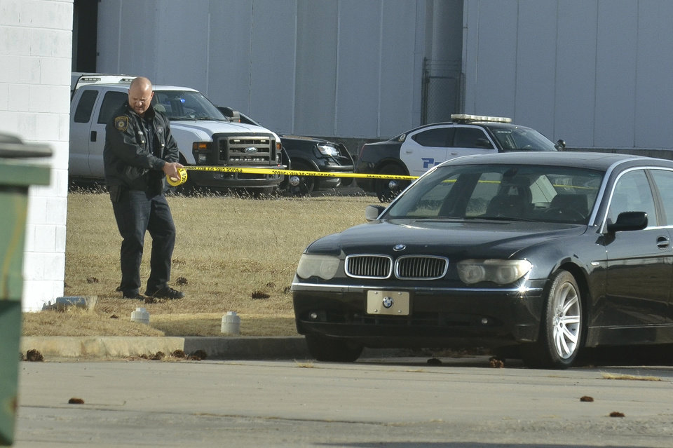 "Photo - Norman Police investigate the scene after reports of a workplace shooting Wednesday, Jan. 10, 2018, on Industrial Blvd., in Norman, Okla. A spokeswoman for police in Norman said the shooting followed a ""domestic situation"" Wednesday between a husband and wife at Bergey Windpower. (Kyle Phillips/The Norman Transcript via AP)"