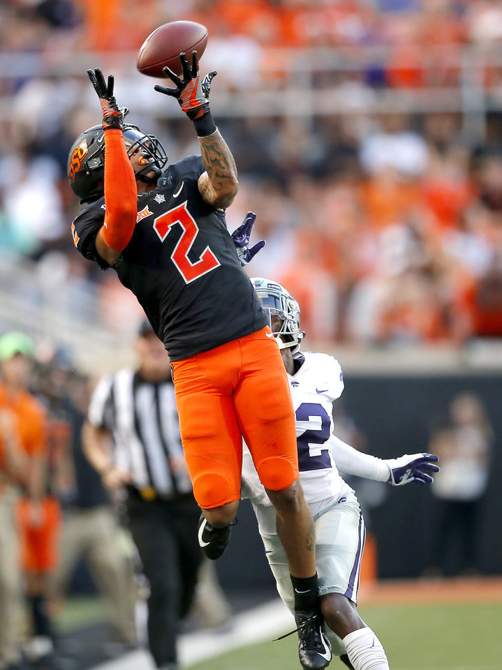 Photo - Oklahoma State's Tylan Wallace (2) makes a reception in front of Kansas State's AJ Parker (12) in the second quarter during the college football game between the Oklahoma State Cowboys and the Kansas State Wildcats at Boone Pickens Stadium in Stillwater, Okla., Friday, Sept. 27, 2019. [Sarah Phipps/The Oklahoman]
