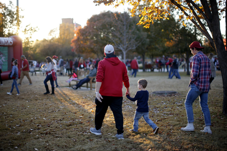 Photo - Fans walk outside the stadium before an NCAA football game between the University of Oklahoma Sooners (OU) and the Iowa State University Cyclones at Gaylord Family-Oklahoma Memorial Stadium in Norman, Okla., Saturday, Nov. 9, 2019. [Bryan Terry/The Oklahoman]