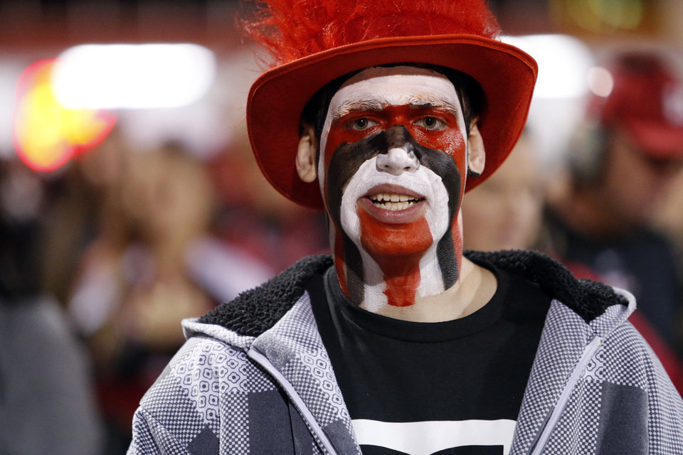Photo - Warriors fan Damon Smith wears his colors as the Nowata Ironmen play the Washington Warriors in high school football on Friday, Nov. 28, 2014 in Washington, Okla. Photo by Steve Sisney, The Oklahoman