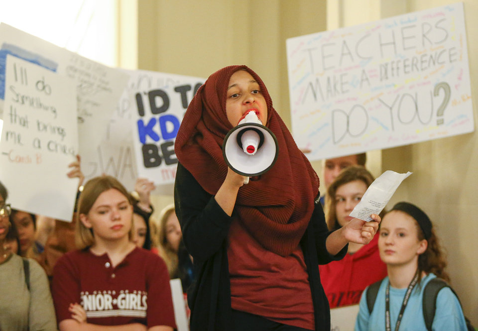 Photo -  Kulsoom Ghias, an Edmond Memorial High School sophomore, speaks at a rally led by students April 9 on the second floor of the state Capitol, during the eighth day of a walkout by Oklahoma teachers. [Photo by Nate Billings, The Oklahoman]