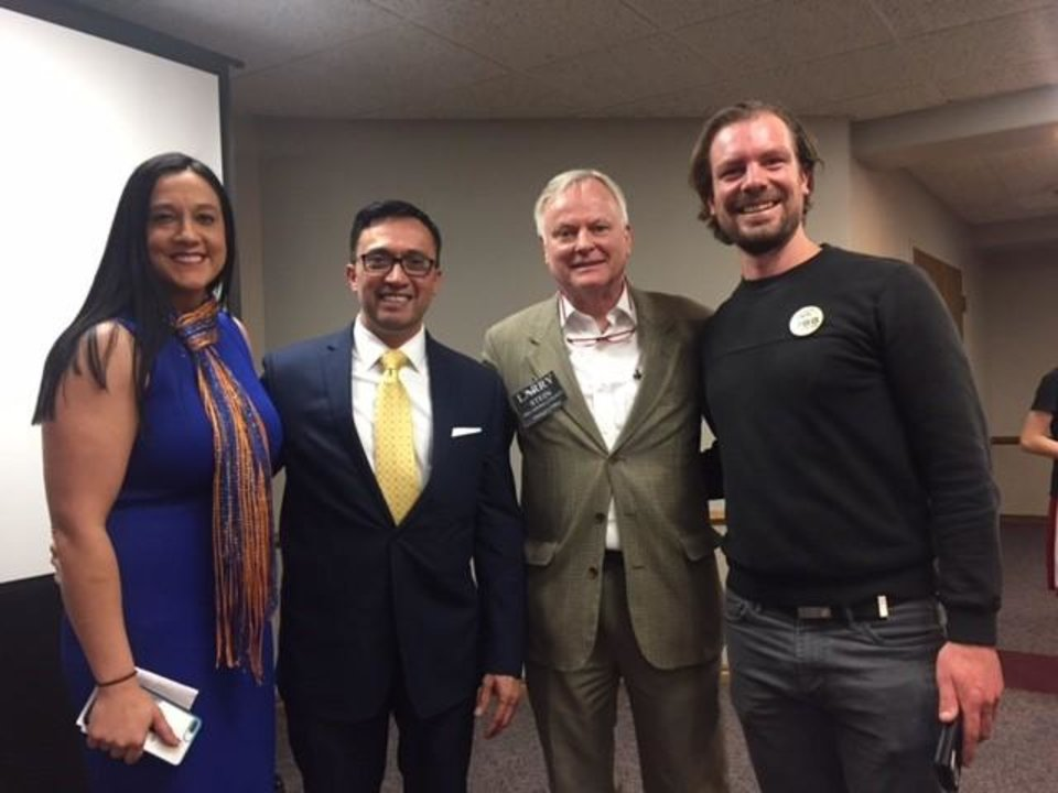 Photo -  Hosts and participants pose after a forum on State Question 788 at the Edmond Community Center on Thursday, April 19, 2018. They are, from left, Heartland Republican Women president Kayla Blount; August Rivera with Oklahomans Against State Questions 788; moderator Larry Stein with the Oklahoma County assessor's office; and Sam Fredrickson, board member of Our Revolution Oklahoma.  [Photo by Justin Wingerter, The Oklahoman]