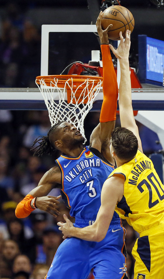 Photo - Oklahoma City's Nerlens Noel (3) blocks a shot by Indiana's Doug McDermott (20) during an NBA basketball game between the Indiana Pacers and the Oklahoma City Thunder at Chesapeake Energy Arena in Oklahoma City, Wednesday, March 27, 2019. Photo by Nate Billings, The Oklahoman