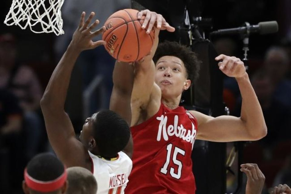 Photo -  Nebraska's Isaiah Roby, right, blocks a shot by Maryland's Darryl Morsell during the Big Ten Conference Tournament last March. Roby was a recent Thunder acquisition from the Dallas Mavericks. [AP Photo/Nam Y. Huh]