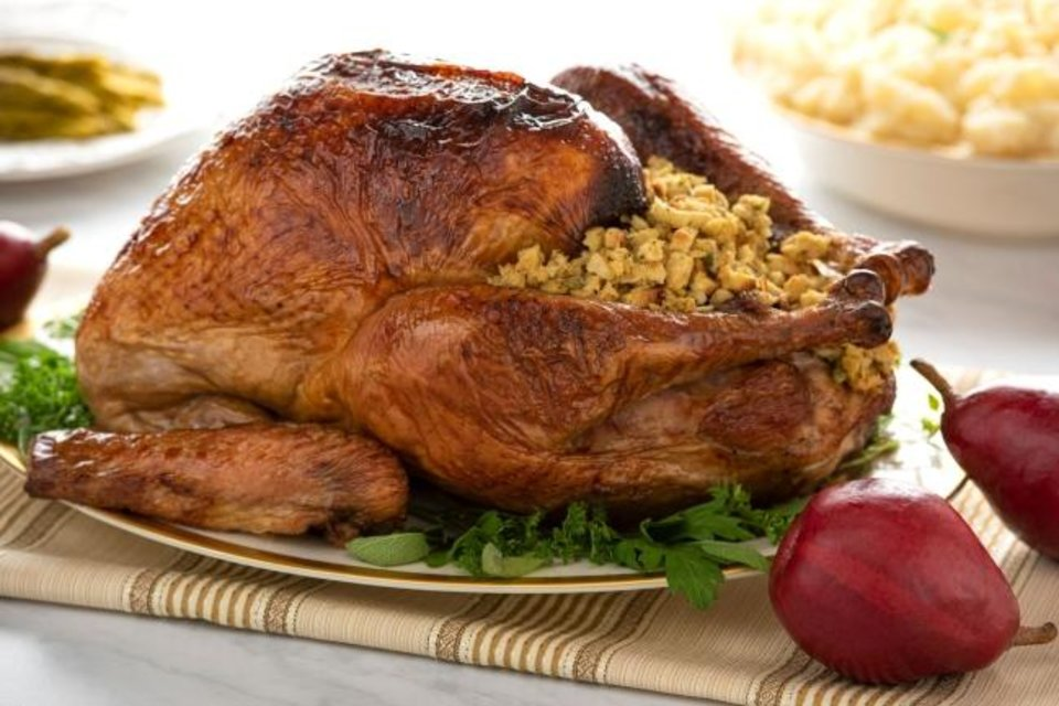 Photo -  This roasted turkey was first brined in Milo's Sweet Tea. [Photo provided]