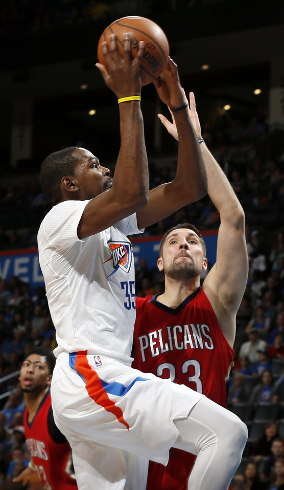 Photo - Oklahoma City's Kevin Durant (35) tries to score against New Orleans' Ryan Anderson (33) during an NBA basketball game between the New Orleans Pelicans and the Oklahoma City Thunder at Chesapeake Energy Arena in Oklahoma City, Thursday, Feb. 11, 2016.  Photo by Nate Billings, The Oklahoman