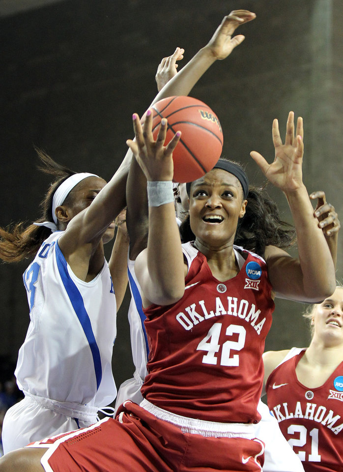 Photo - Oklahoma's Kaylon Williams (42) shoots while defended by Kentucky's Evelyn Akhator during a second round women's college basketball game in the NCAA Tournament in Lexington, Ky., Monday, March 21, 2016. (AP Photo/James Crisp)