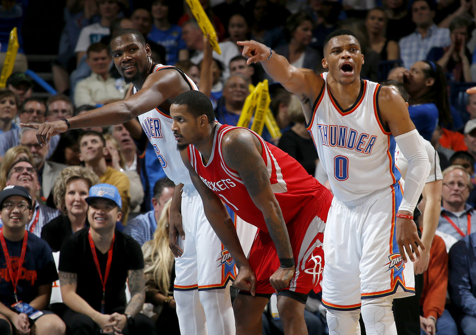 Photo - Oklahoma City's Kevin Durant (35) and Russell Westbrook (0) shout instruction as they wait for a free throw beside Houston's Trevor Ariza (1) during an NBA basketball game between the Oklahoma City Thunder and the Houston Rockets at Chesapeake Energy Arena in Oklahoma City, Friday, Jan. 29, 2016. Oklahoma City won 116-108. Photo by Bryan Terry, The Oklahoman