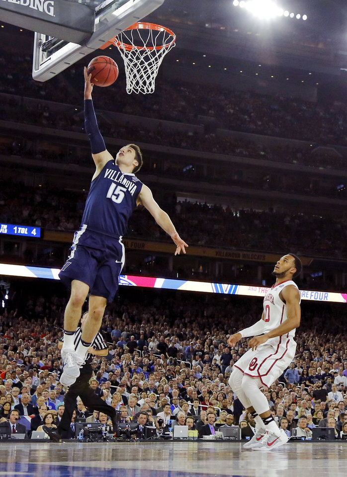 Photo - Villanova's Ryan Arcidiacono (15) lays up a shot in front of Oklahoma's Jordan Woodard (10) during the national semifinal between the Oklahoma Sooners (OU) and the Villanova Wildcats in the Final Four of the NCAA Men's Basketball Championship at NRG Stadium in Houston, Saturday, April 2, 2016. Photo by Nate Billings, The Oklahoman