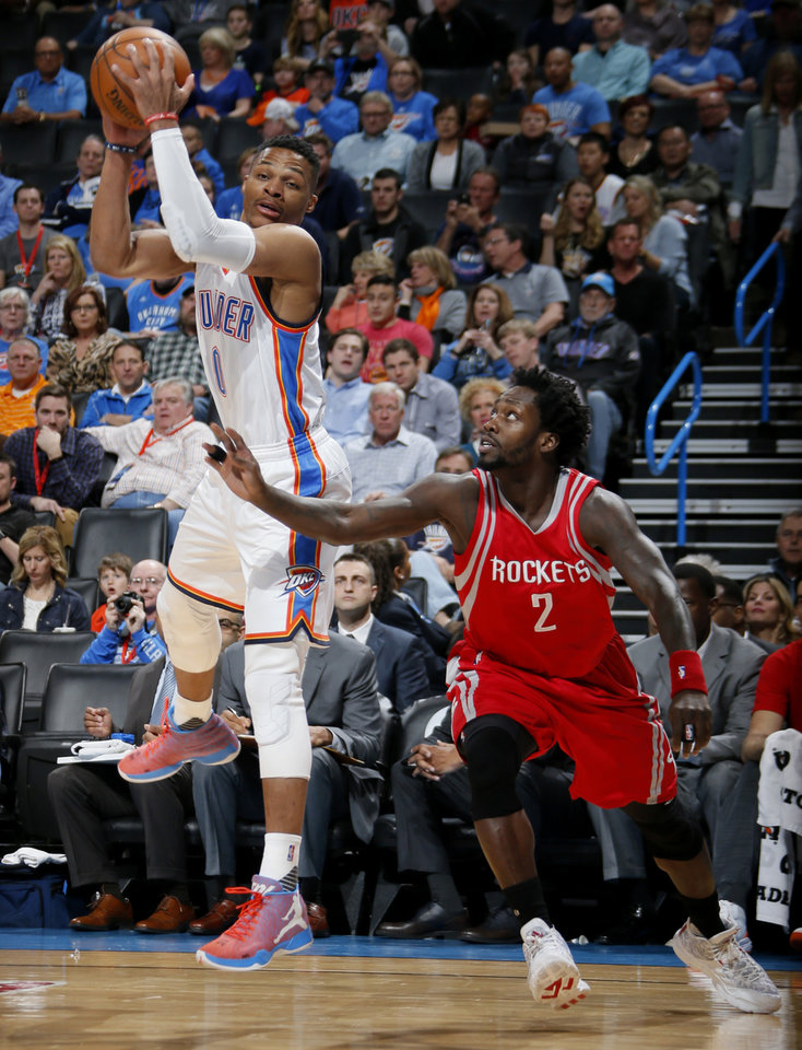 Photo - Oklahoma City's Russell Westbrook (0) grabs the ball in front of Houston's Patrick Beverley (2) during an NBA basketball game between the Oklahoma City Thunder and the Houston Rockets at Chesapeake Energy Arena in Oklahoma City, Friday, Jan. 29, 2016. Photo by Bryan Terry, The Oklahoman
