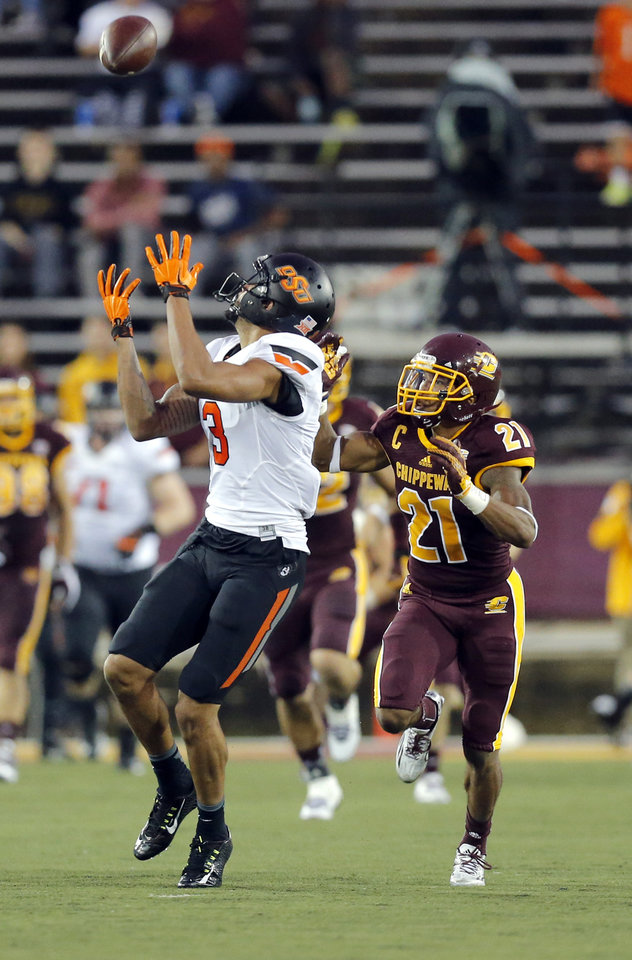 Photo - Oklahoma State's Marcell Ateman (3) makes a catch as /during the college football game between the Central Michigan Chippewas and the Oklahoma State University Cowboys at the Kelly-Shorts Stadium in Mount Pleasant, Mich., Thursday, Sept. 3, 2015. Photo by Sarah Phipps, The Oklahoman