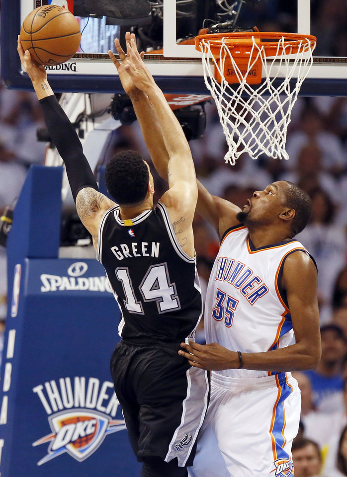 Photo - Oklahoma City's Kevin Durant, right, defends San Antonio's Danny Green during Game 4 of the Western Conference semifinals between the Thunder and Spurs in the NBA playoffs on sunday at Chesapeake Energy Arena. (Photo by Nate Billings, The Oklahoman)