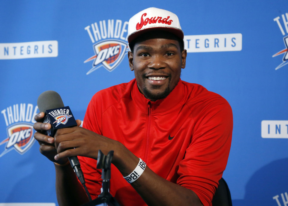 ca7a1a8b3a17 Oklahoma City Thunder forward Kevin Durant smiles during an NBA basketball  news conference in Oklahoma City