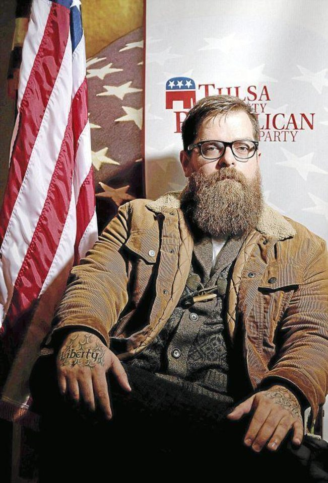Photo - T.C. Ryan poses at the Republican Party of Tulsa County headquarters in January after he was elected to serve as a state committeeman for the Republican Party of Tulsa County. JOHN CLANTON/Tulsa World file
