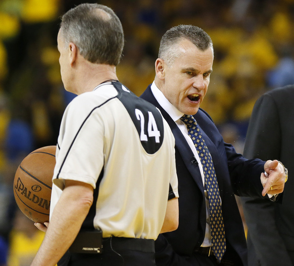 Photo - Oklahoma City coach Billy Donovan complains to official Mike Callahan in the third quarter during Game 2 of the Western Conference finals in the NBA playoffs between the Oklahoma City Thunder and the Golden State Warriors at Oracle Arena in Oakland, Calif., Wednesday, May 18, 2016. Golden State won 118-91. Photo by Nate Billings, The Oklahoman
