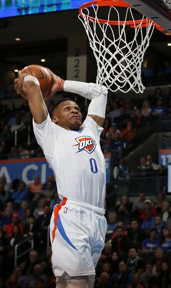 Photo - Oklahoma City's Russell Westbrook (0) dunks the ball during an NBA basketball game between the New Orleans Pelicans and the Oklahoma City Thunder at Chesapeake Energy Arena in Oklahoma City, Thursday, Feb. 11, 2016.  Photo by Nate Billings, The Oklahoman