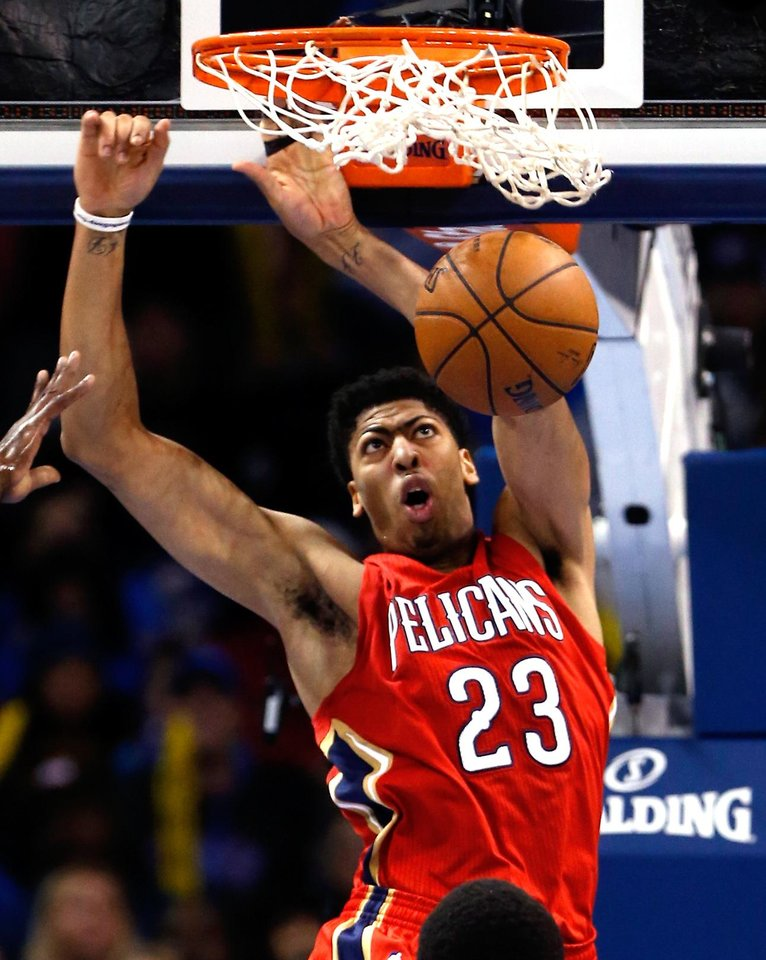 Photo - Pelican's Anthony Davis (23) dunks during  the second half of an NBA basketball game between the Oklahoma City Thunder and the New Orleans Pelicans at Chesapeake Energy Arena on Dec. 21, 2014 in Oklahoma City, Okla. Photo by Steve Sisney, The Oklahoman