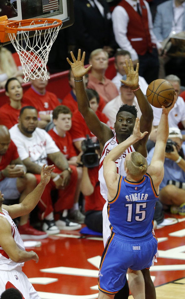 Photo - Oklahoma City's Kyle Singler (15) shoots over Houston's Clint Capela (15) during Game 2 in the first round of the NBA playoffs between the Oklahoma City Thunder and the Houston Rockets in Houston, Texas,  Wednesday, April 19, 2017.  Photo by Sarah Phipps, The Oklahoman
