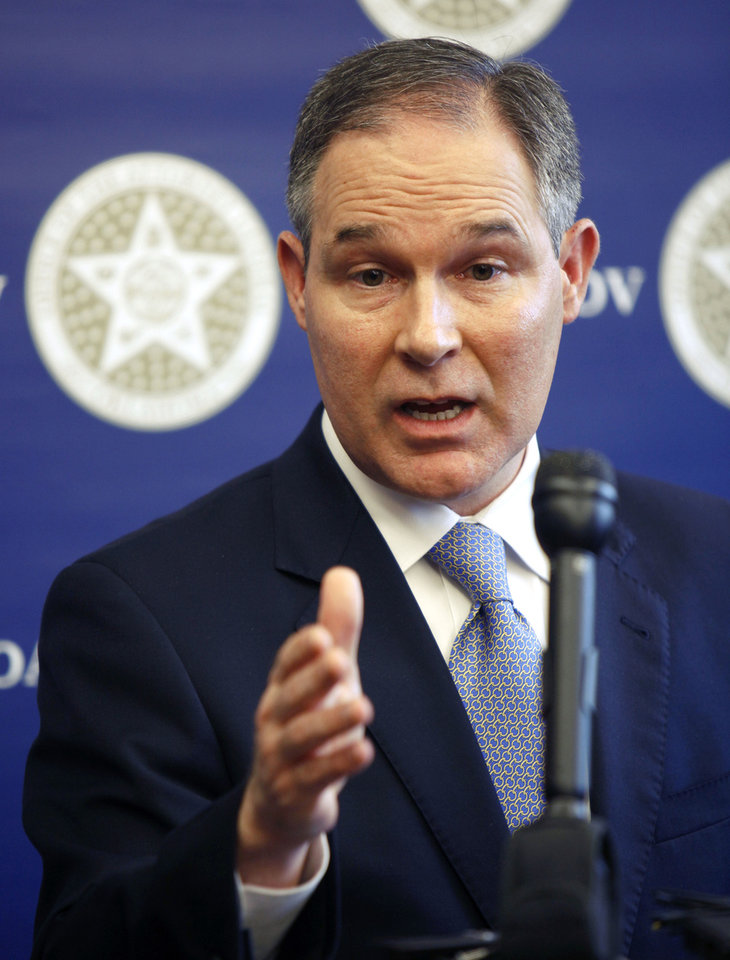 Photo - MORTGAGE SETTLEMENT: Oklahoma Attorney General E. Scott Pruitt speaks to reporters about the settlement reached by his office with various home mortgage lenders, during a press conference at his office in Oklahoma City, OK, Thursday, Feb. 9, 2012. By Paul Hellstern, The Oklahoman