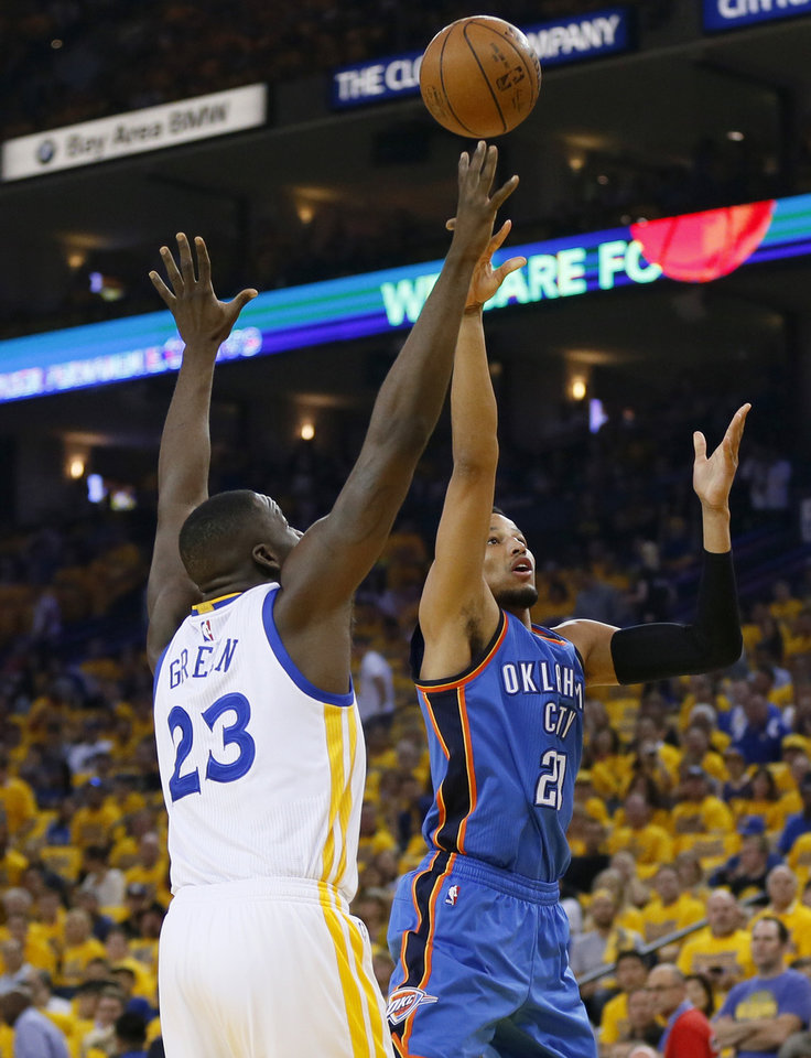 Photo - Oklahoma City coach Billy Donovan must make Golden State pay for ignoring Andre Robertson, right, shown here going past the Warriors' Draymond Green during Game 2 of the Western Conference finals. (Photo by Nate Billings, The Oklahoman)
