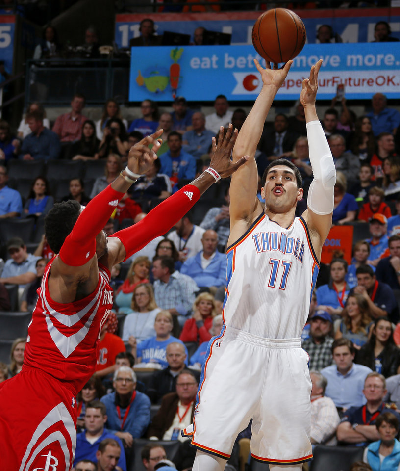 Photo - Oklahoma City's Enes Kanter, right, shoots over Houston's Dwight Howard during Friday night's NBA game at Chesapeake Energy Arena. Oklahoma City won, 116-108. (Photo by Bryan Terry, The Oklahoman)