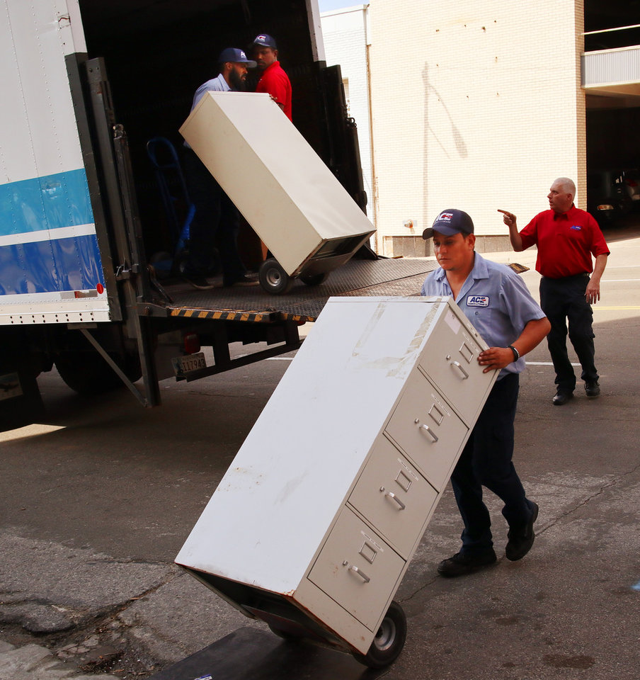 Photo -  Dozens of file cabinets were unloaded Thursday afternoon from a moving truck parked outside the Oklahoma City National Memorial & Museum. [Photo by Doug Hoke, The Oklahoman]