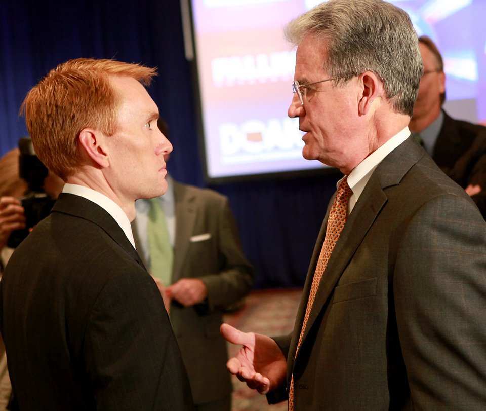 Photo - James Lankford (left) and Sen. Tom Coburn talk during the Republican Watch Party at the Marriott in Oklahoma City on Tuesday, Nov. 2, 2010.Photo by John Clanton, The Oklahoman
