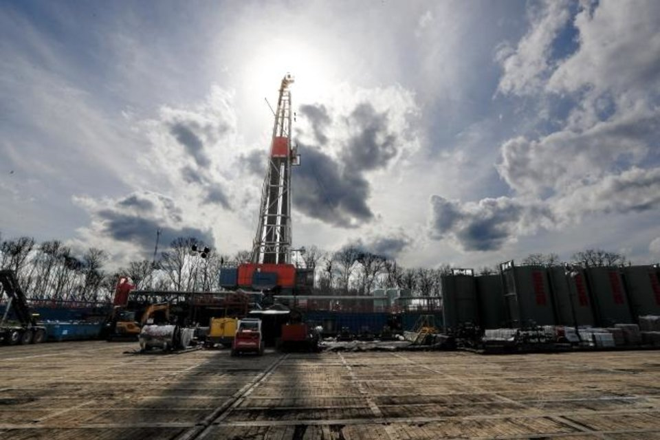 Photo -  A rig drills a well in the Appalachian Basin's Marcellus Shale field in Pennsylvania. [THE ASSOCIATED PRESS]
