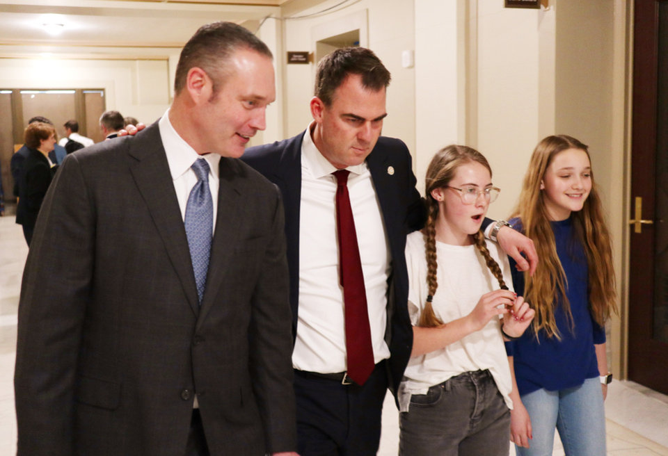 Photo - Oklahoma House Speaker Charles McCll joins Gov. Kevin Stitt and his daughters in the hall after a press conference Monday, March 16, 2020.  [Photo by Doug Hoke/The Oklahoman]