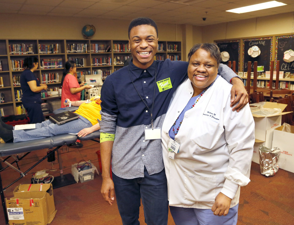 Photo -   At left:  Carlos Jackson and his grandmother, Wilma Morris, pause for a photo during the first blood drive at Oklahoma Centennial Mid-High School. Morris is a longtime employee of the Oklahoma Blood Institute, where Jackson volunteers. [Photos by [Paul Hellstern, The Oklahoman]