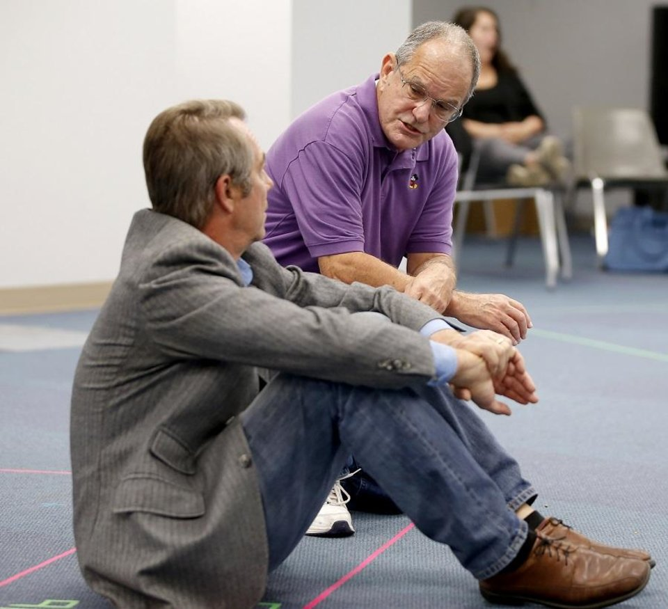 Photo - Terry Veal, as Judge Taylor, talks with Eric Starkey, as Atticus Finch, during a rehearsal for Oklahoma Children's Theatre and TheatreOCU's co-production of